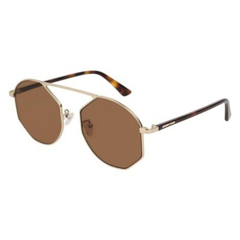 Gafas geométricas McQ con lentes marrones.