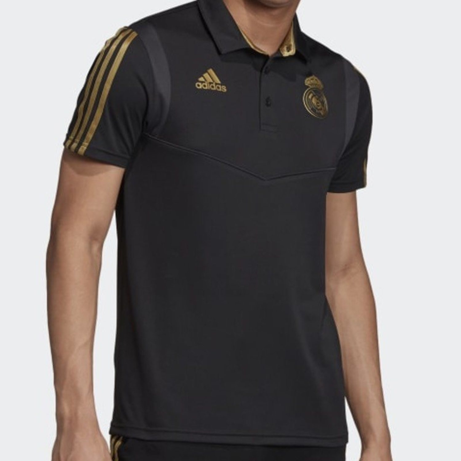 Polo en tonos negro y dorado Real Madrid