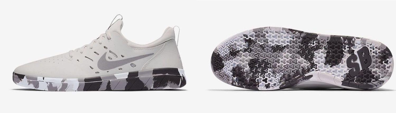 Zapatillas grises con suela de camuflaje de Nike.